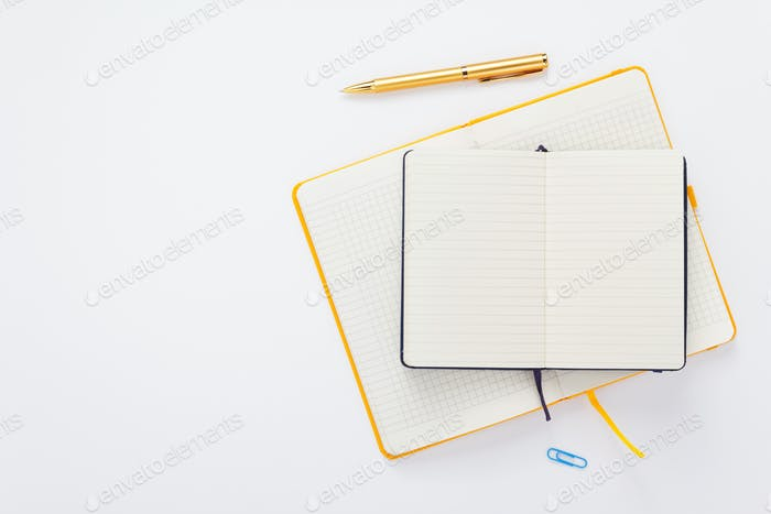 notebook and pen at white background