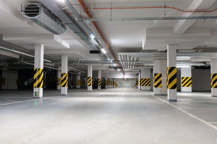 Underground empty parking garage. Modern urban space