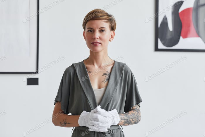 Female Expert in Modern Art Gallery