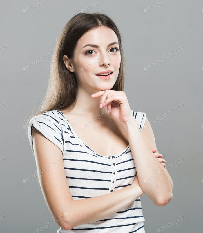 Happy woman.Emotional face woman portrait, beautiful female over gray background posing