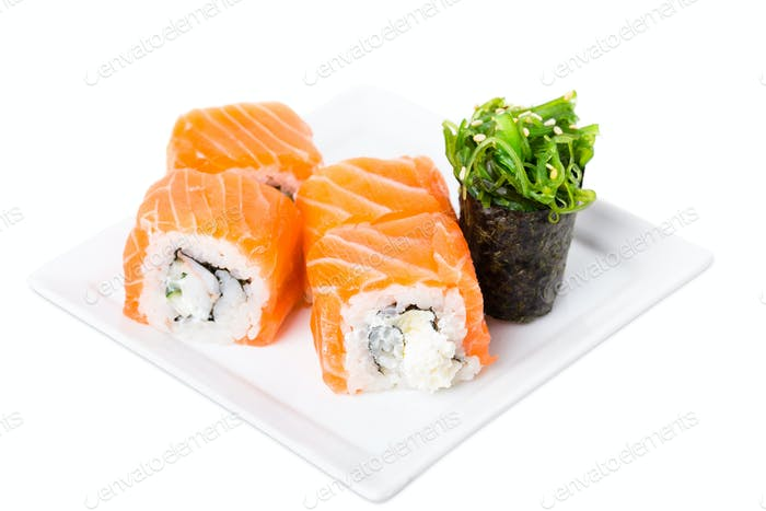 Salmon sushi roll with snow crab and cucumber.