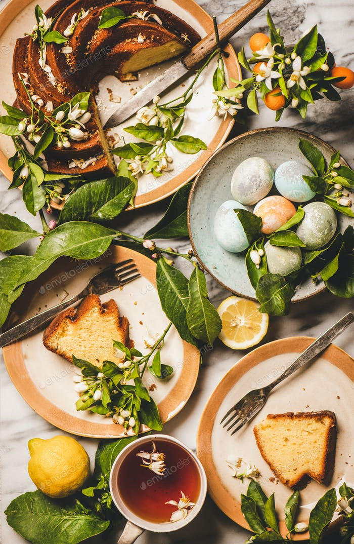 Easter table setting with colorful eggs and citrus cake