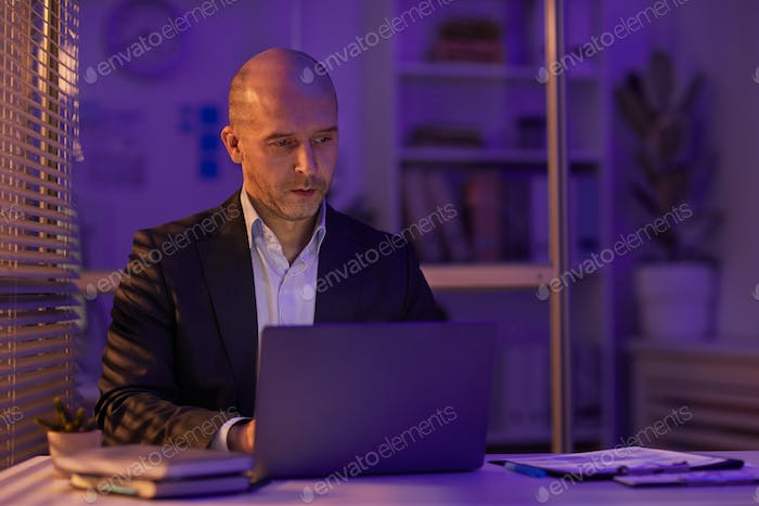 Man Working Alone In Evening
