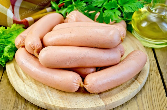 Sausages on a board with parsley