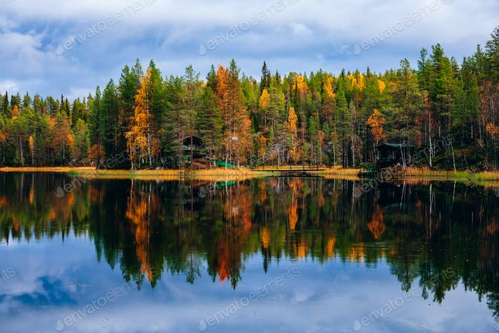 Autumn landscape. Fall colors reflection in lake in Finland