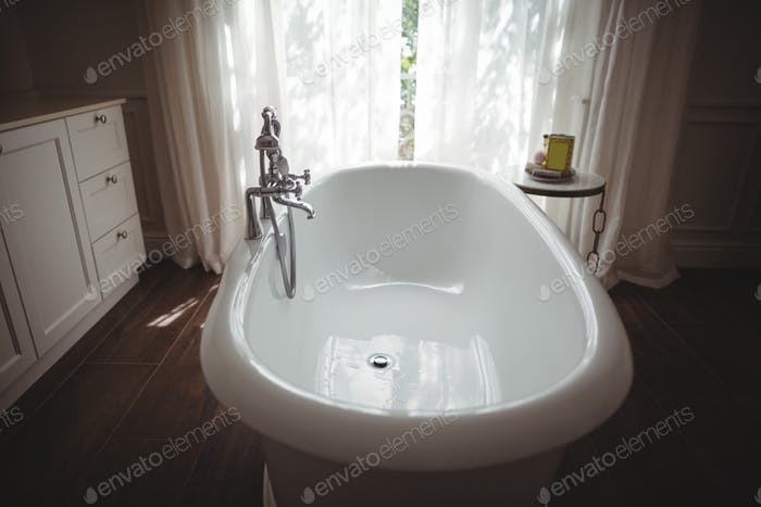 Interior view of bathtub and tap