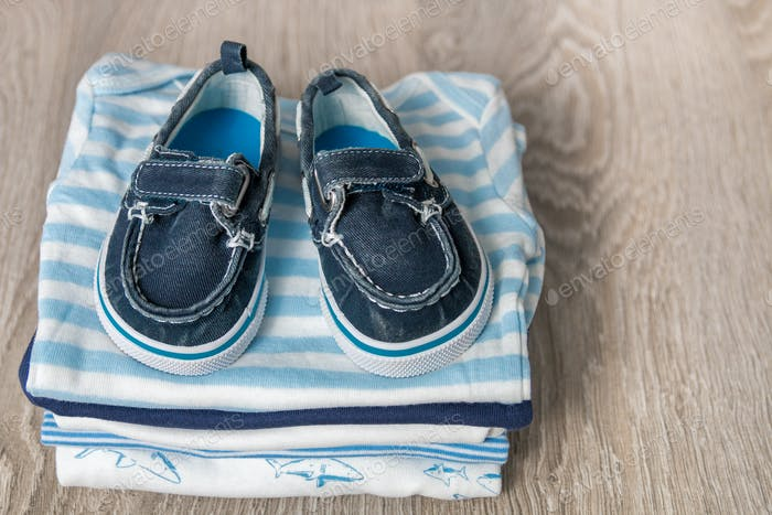 Folded blue and white bodysuit with shoes