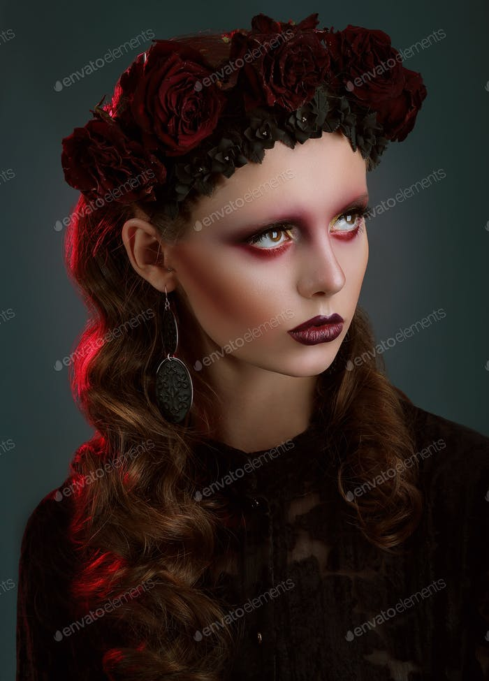 Trendy fashion model with dark wreath of roses