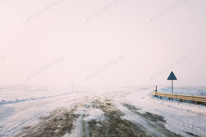 Snow-covered Road During A Snowstorm In Winter. Open Road