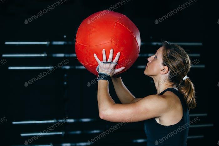 Girl doing wall ball exercise