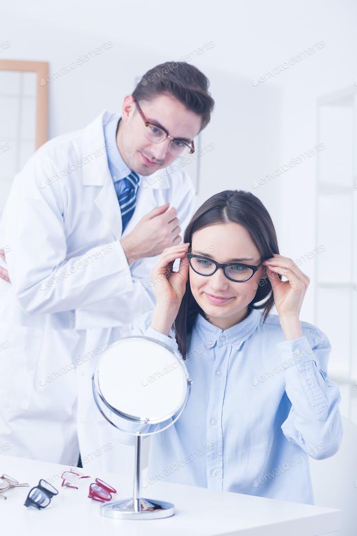 Optician advising client