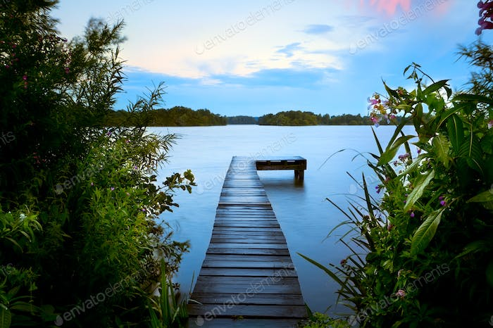 wooden pier in summer on lake