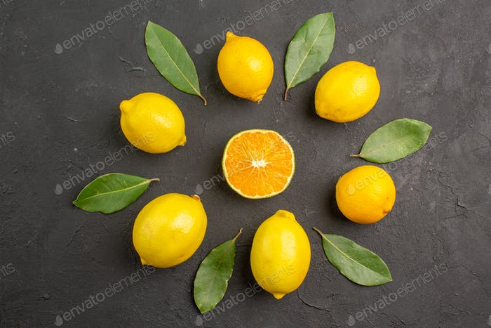 top view fresh sour lemons lined on dark background citrus lime fruit yellow