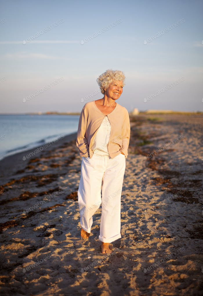 Senior woman walking on the beach