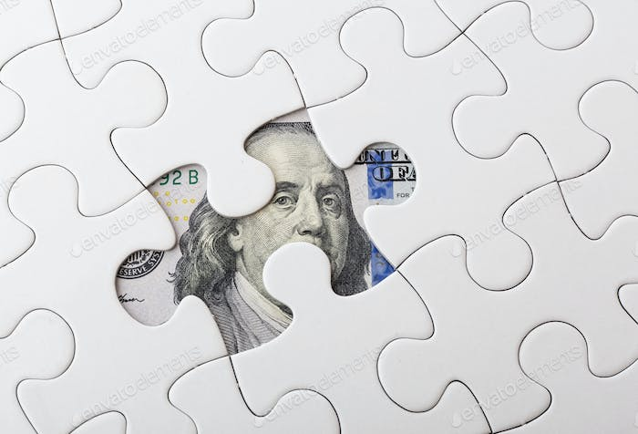White puzzle with American dollar