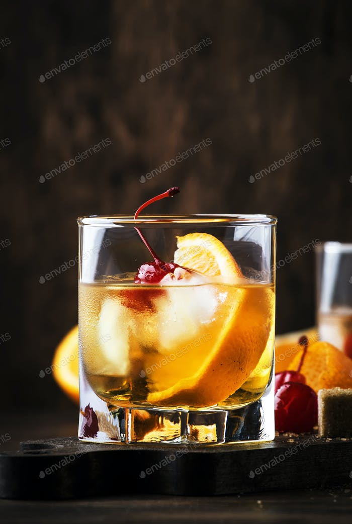 Old Fashioned - classic alcoholic cocktail with bourbon whiskey, bitter, cane sugar and ice