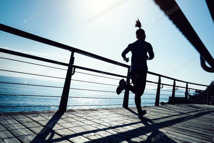 Running on seaside boardwalk