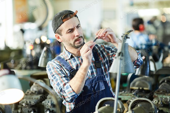 Mature Man Working at Plant