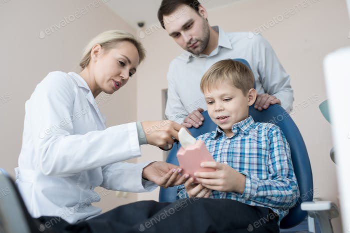 Little Boy Visiting Dentist with Dad