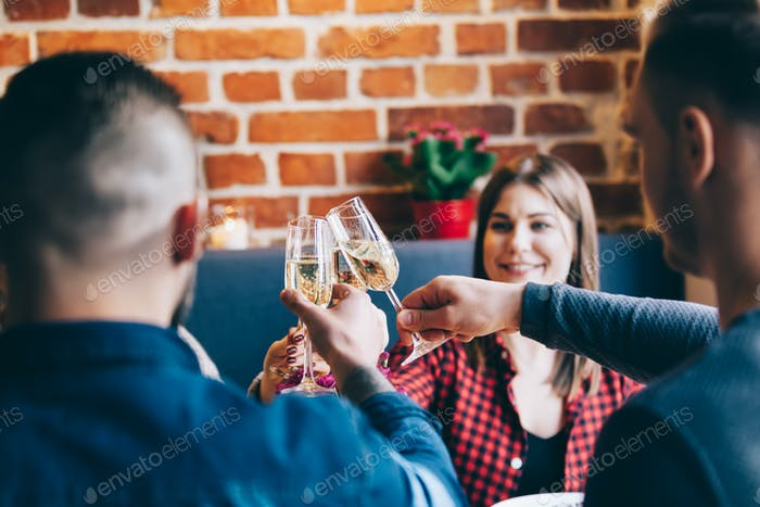Friends toasting together in a restaurant,