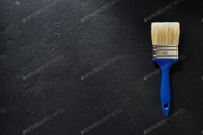 paintbrush tool at black background