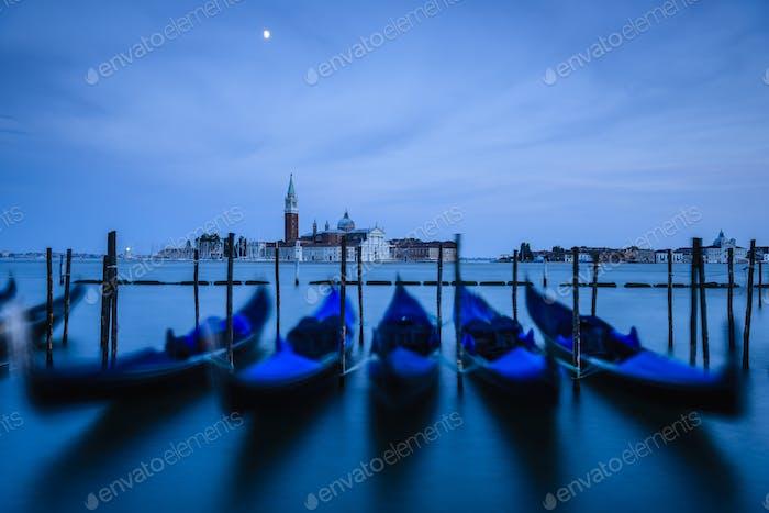 Blue gondolas at night