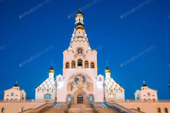 Minsk, Belarus. Night View Of All Saints Church. Minsk Memorial