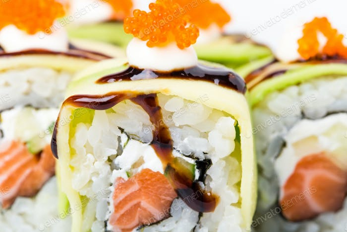 Delicious avocado sushi roll with salmon.