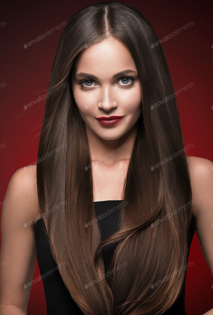 Beautiful hair woman long smooth beautiful hairstyle red lips over red background