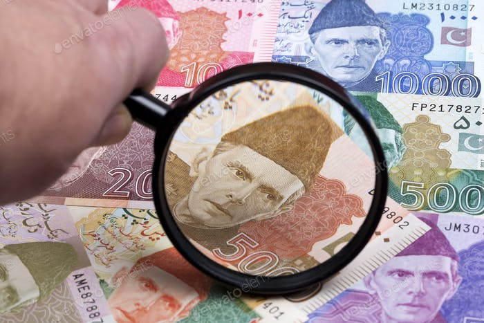 Pakistani rupee in a magnifying glass