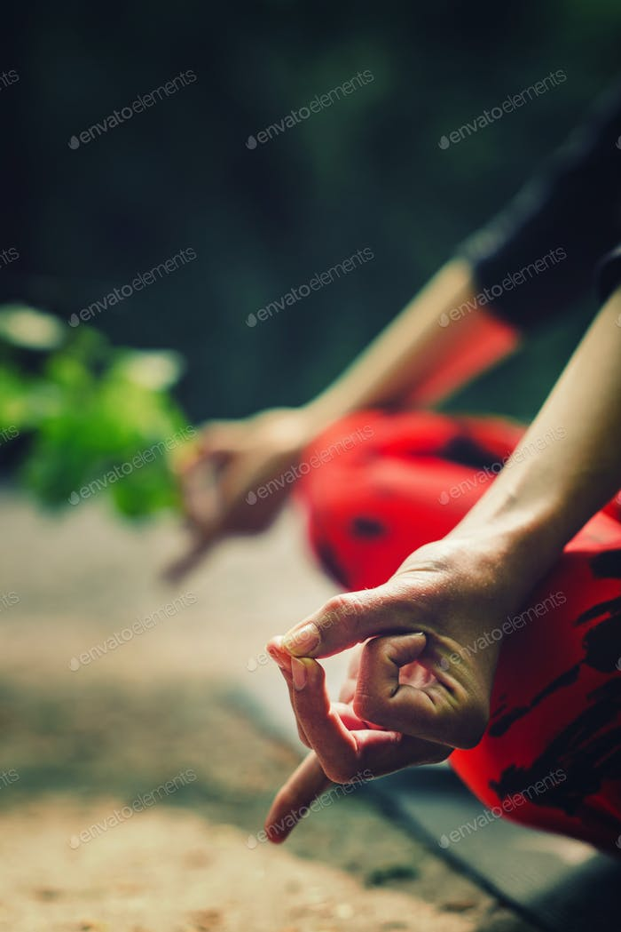 Meditation detail. Close-up on hands of a young woman meditating