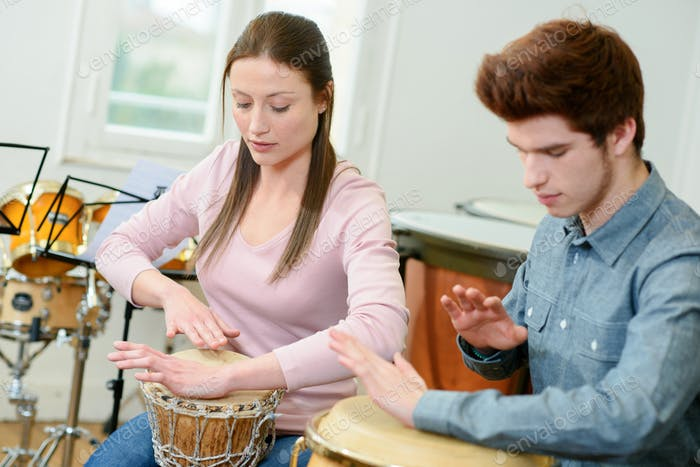 couple playing percussion