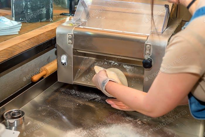 Working on dough sheeter