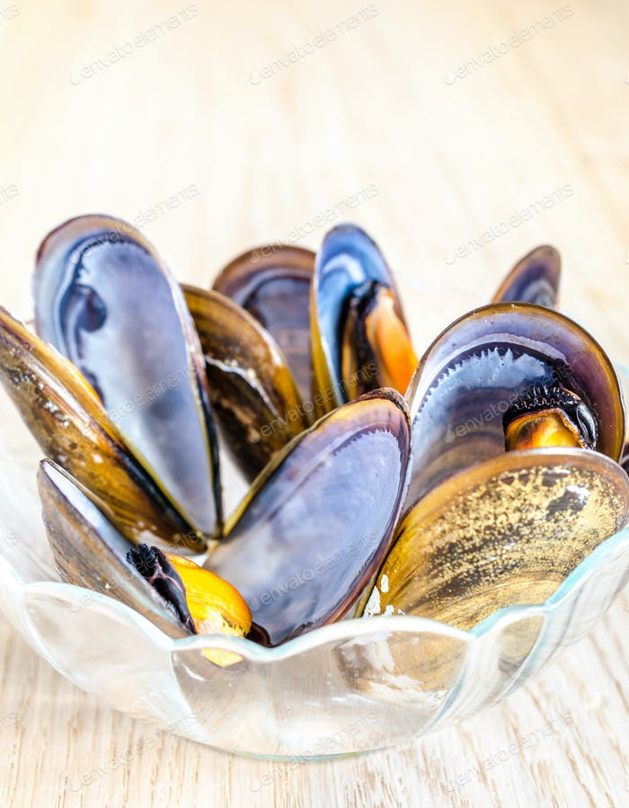 Bowl of mussels on the wooden table