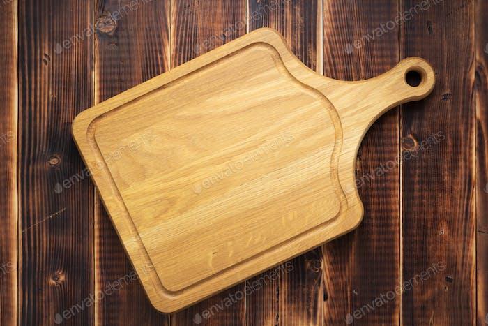 Panel de cortar en el Fondo rústico tablón de De madera
