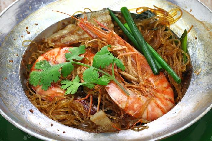 thai cuisine, steamed prawns with vermicelli in metal casserole pot, gung op wun sen