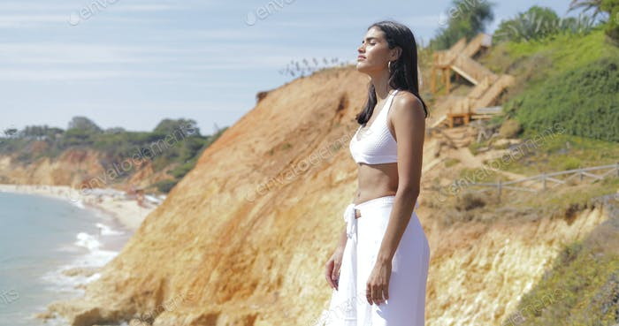 Dreaming model in white on landscape