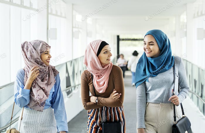 Islamic women friends walking and discussing together