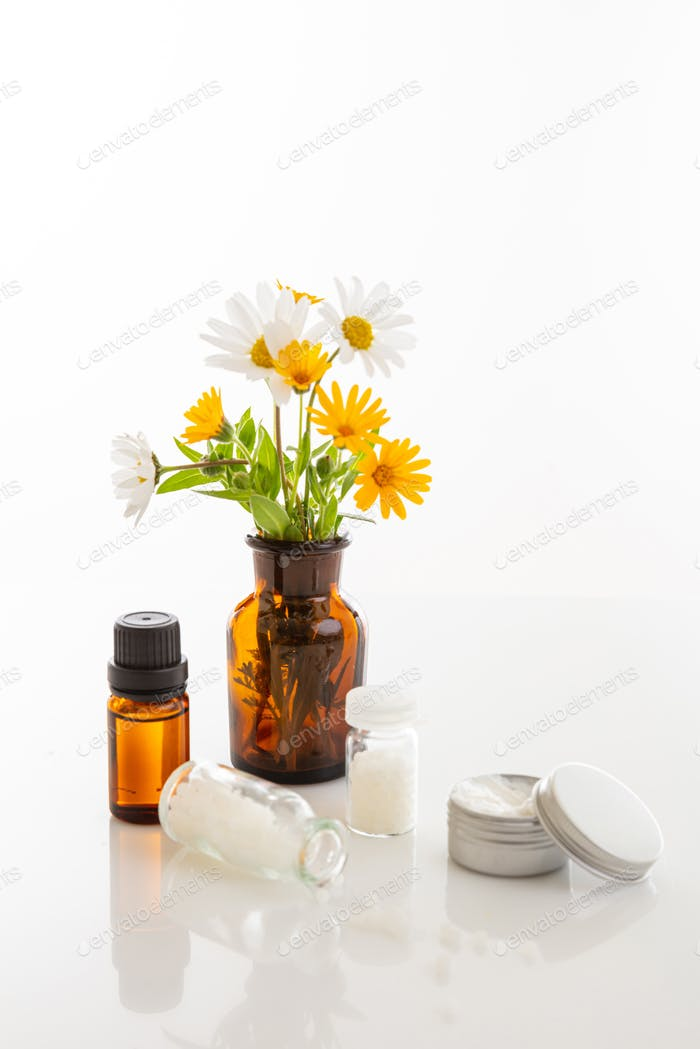 Wild flowers and herbal medicine products isolated on white background