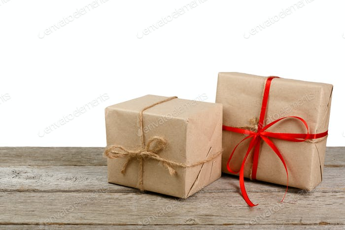 Christmas gift boxes in craft paper isolated on white