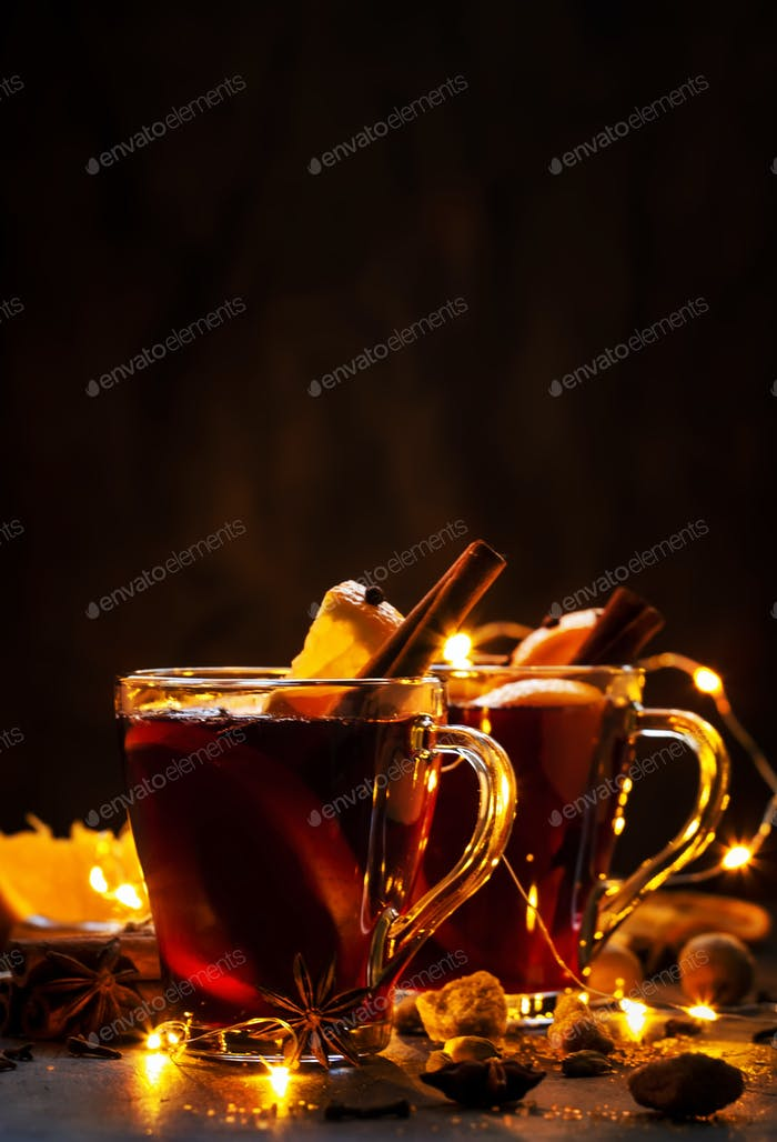 Traditional Christmas or New Year hot drink in festive light table setting