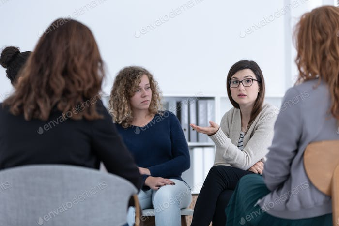 Women with problems sitting together during counseling