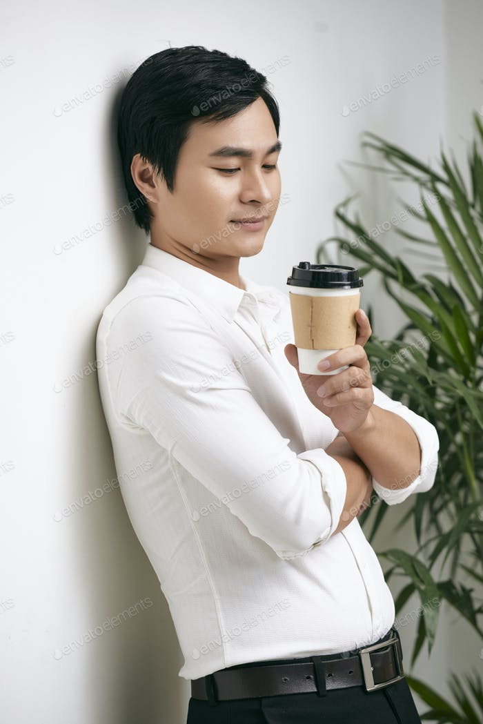 Pensive businessman with coffee