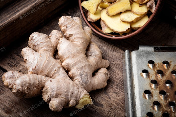 Fresh ginger on rustic background