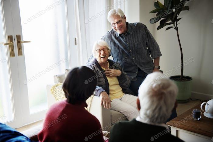 Senior people talking in living room