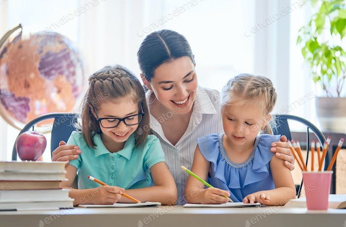 Mother and daughters are learning to write