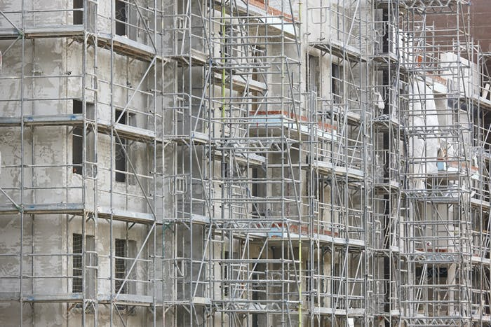 Scaffolding structure on a building. Construction architecture industry. Workplace