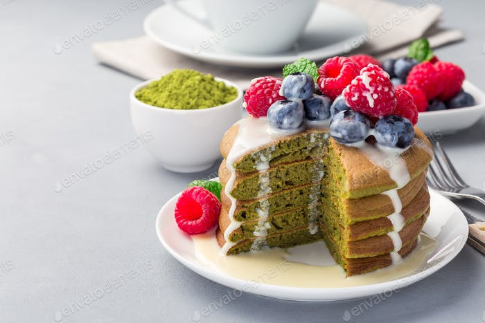 Cuted stack of matcha pancakes, horizontal, copy space