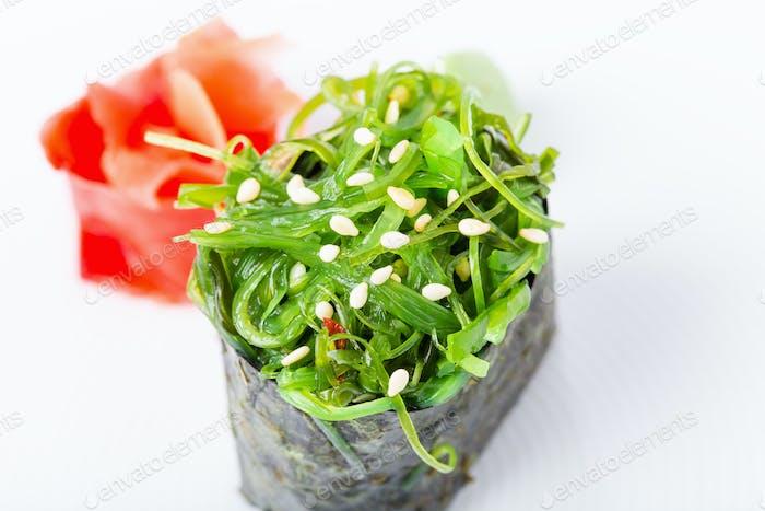Gunkan sushi with seaweed and marinated ginger.
