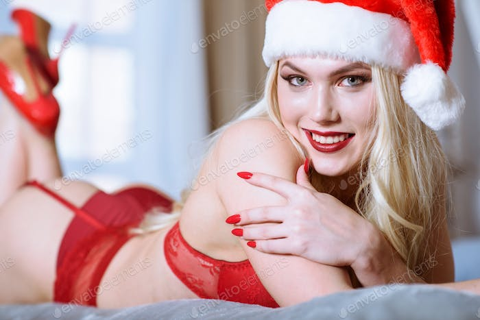 Blonde sexy Santa Clause in elegant panties, hat, shoes and bra